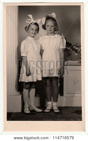 A vintage photo of the young girls - the first holy