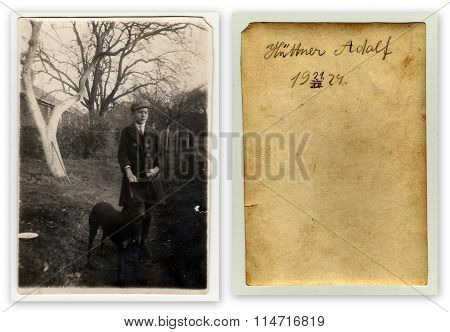 Front and back of photo. The boy with a dog on a walk