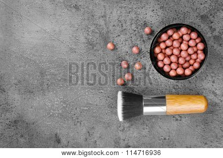 Make-up brush and blusher, on grey background