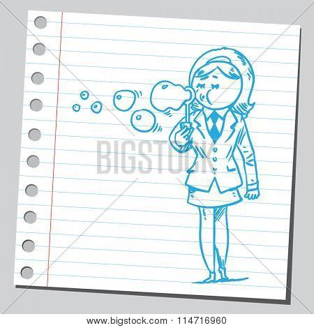 Businesswoman blowing soap bubbles