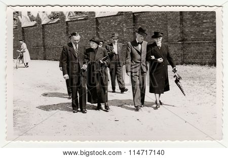Vintage photo shows a group of people during a walk