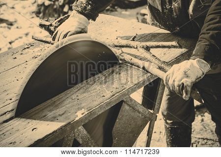Man working with old handmade circular saw blade