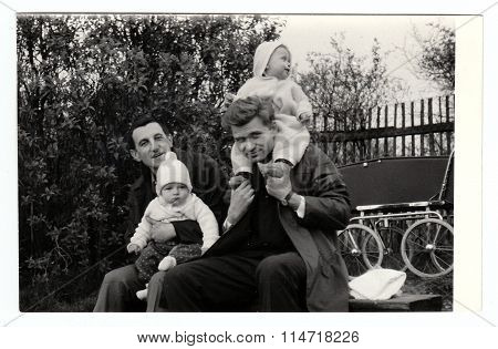 Retro photo shows fathers with their baby children