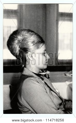 Vintage photo of young woman circa