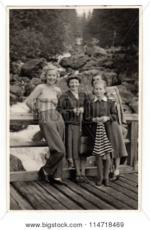 A vintage photo shows people on vacation