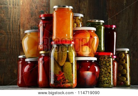 Jars With Pickled Vegetables, Fruity Compotes And Jams