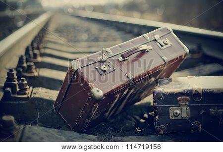 Old Vintage Suitcases On Railway Rails.