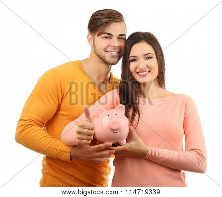 Couple pig money box and banknotes isolated on white