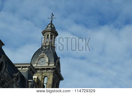 a weather vane on top of a stone clock