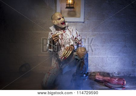 zombie, Man chained with blood and knife, has a severed leg blood