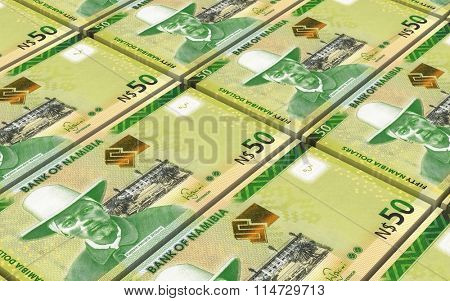 Namibian dollars bills stacks background. Computer generated 3D photo rendering.