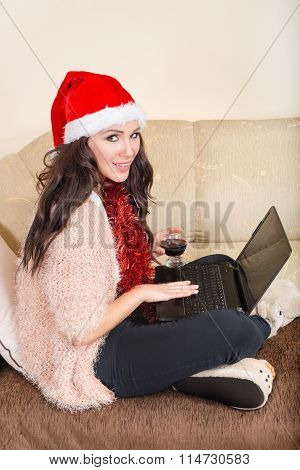 Young Woman Posing With Red Santa Hat And Red Wine