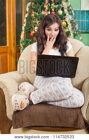 Surprised Girl Using Laptop Computer Sitting On Sofa Relaxed Indoors