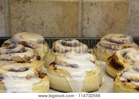 Hot homemade cinnamon rolls fresh out of the oven freshly glazed