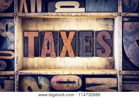 Taxes Concept Letterpress Type