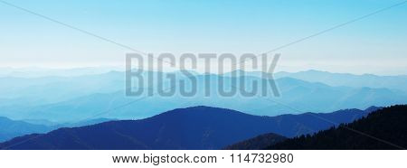 panorama view of smoky mountain range in blue