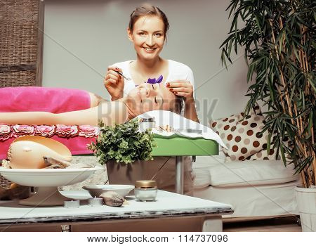 stock photo attractive lady getting spa treatment in salon, massage doctor smiling care pretty
