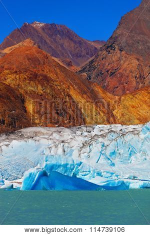 Excursion by boat to the huge blue-white glacier. Unique lake Viedma in Argentine Patagonia. The lake is surrounded by mountains
