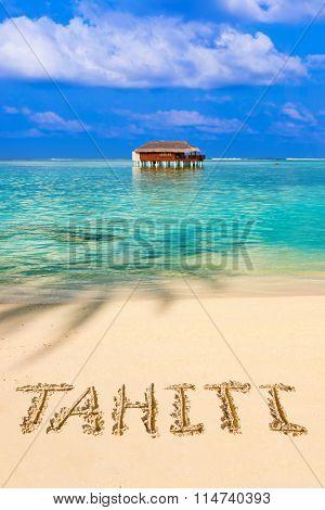 Word Tahiti on beach - nature holiday background
