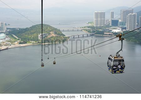 HONG KONG - MAY 11, 2012: view from Ngong Ping 360 cable car. The Ngong Ping 360 is a tourism project on Lantau Island in Hong Kong.