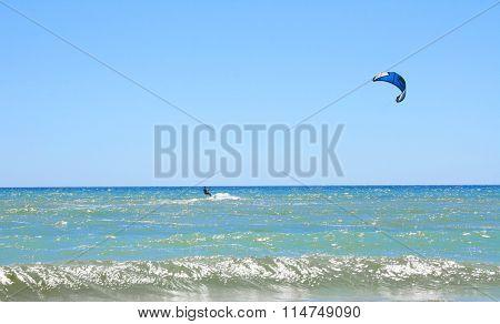 Kiteboarding wind sport on summer vacation on sea coast