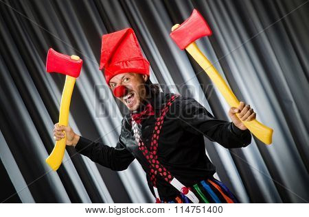 Funny clown with red axe