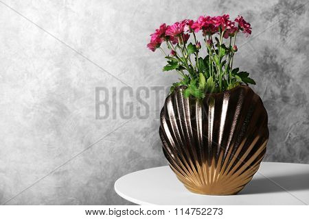 Chrysanthemums in vase on table