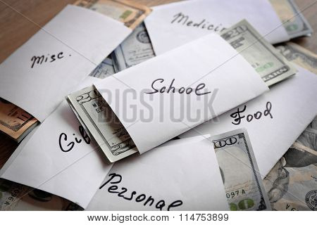 Rolls of money for needs on wooden background