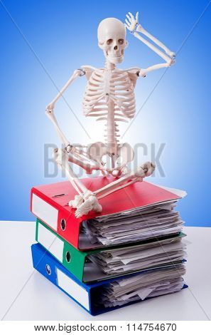 Skeleton with pile of files against gradient