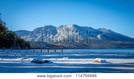 Snow Covered Beach And Mountains At Lake Tahoe, California