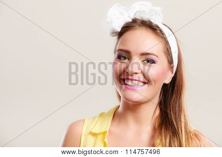 Portrait Of Happy Pretty Pin Up Girl With Bow.