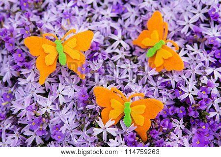 Orange Felt Butterflies With A Sea Of Purple Blossoms