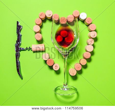 Glass Of Red Wine ,corkscrew And Cork Stoppers Forming A Heart