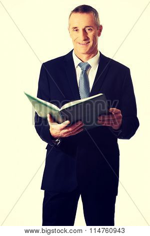 Businessman reading his note book