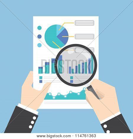 Businessman Hands Holding A Magnifying Glass And Analysing The Data