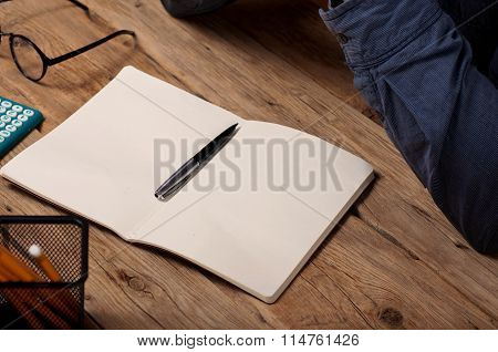 Blank Open Notepad With A Pen
