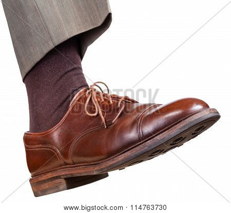 Male Right Foot In Brown Shoe Takes A Step
