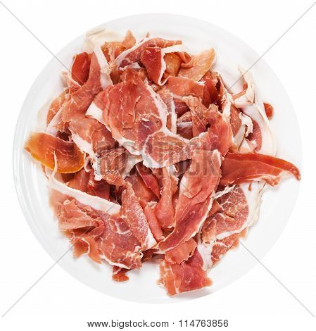 Top View Of Thin Sliced Jamon On Plate Isolated