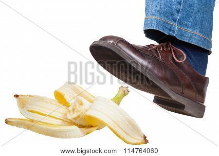Left Foot In Jeans And Shoe Slips On Banana Peel