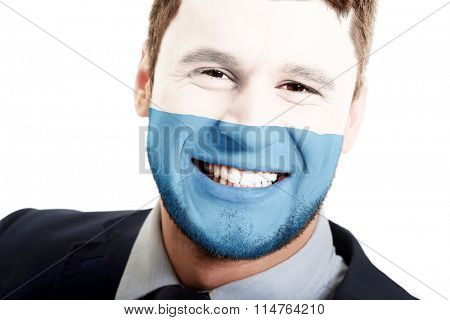 Happy man with San Marino flag on face.