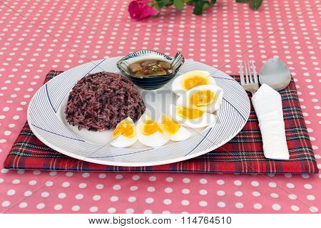 Boiled Egg Slice And Cooked Rice On Dish
