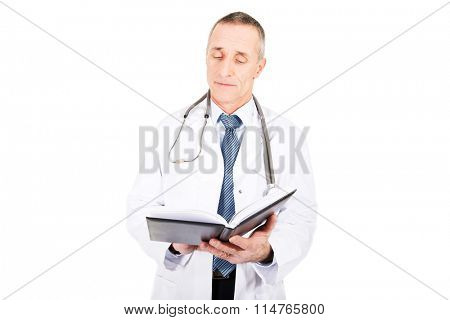 Male doctor holding notebook