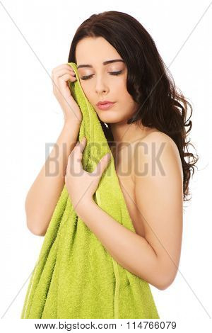 Woman with towel and eyes closed.