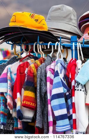 sweaters and hats in a market in Peru