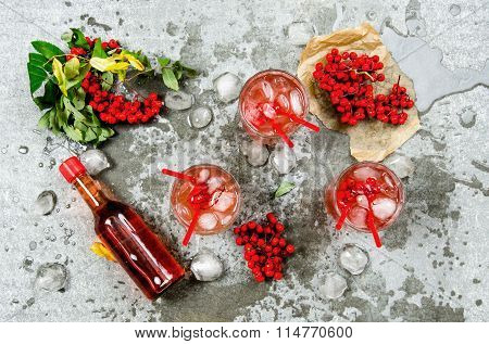Three Cocktails With Ice.  Ingredients - Liquor, Berries, Juice, And Clean Water On The Stone Table.