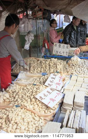 Kunming, China - January 9, 2016: Man Selling Different Varieties Of Tofu In A Market In Kunming, Ch
