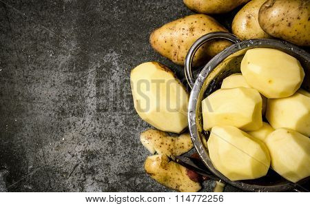 The Concept Of Wet Peeled Potatoes On A Stone Background . Free Space For Text.