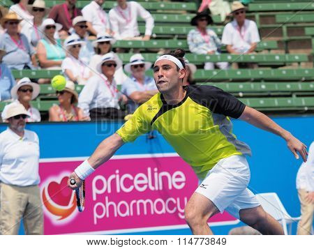 Marcos Bahdatis stretches for a forehand