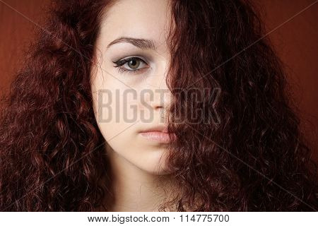 sullen girl with natural curly hair