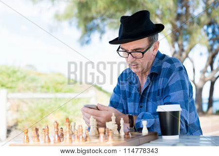 Old man with his mobile